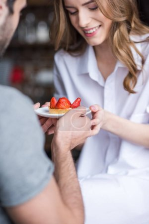 Couple with strawberry cake