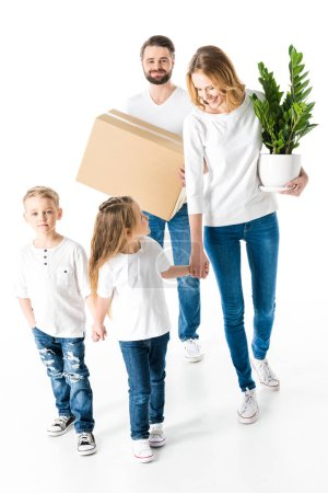 Photo for Happy family with cardboard box and green plant moving into new house  isolated on white - Royalty Free Image