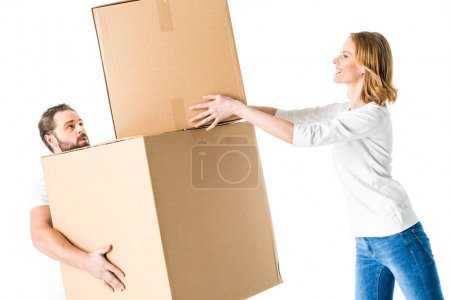 Photo for Young couple holding cardboard boxes  isolated on white - Royalty Free Image