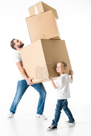 Photo for Father and son with cardboard boxes moving to new house  isolated on white - Royalty Free Image