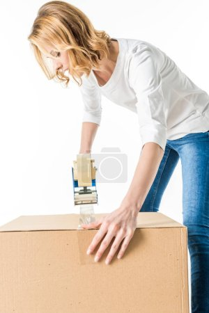 Photo for Young woman packing cardboard box  isolated on white - Royalty Free Image