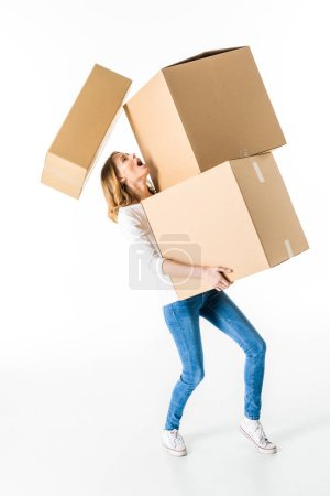 Photo for Young woman holding stack of cardboard boxes  isolated on white - Royalty Free Image