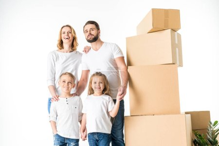 Photo for Happy young family with cardboard boxes moving to new house  isolated on white - Royalty Free Image
