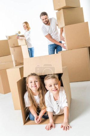 Kids in cardboard box