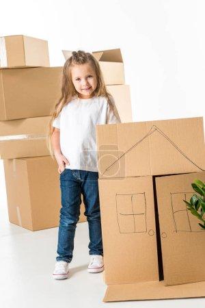 Little girl near cardboard box