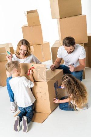 Family drawing on cardboard box