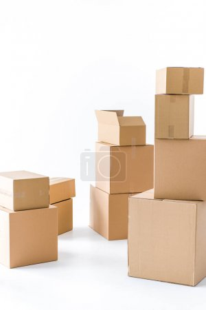 Photo for Piles of stacked brown cardboard boxes  isolated on white - Royalty Free Image