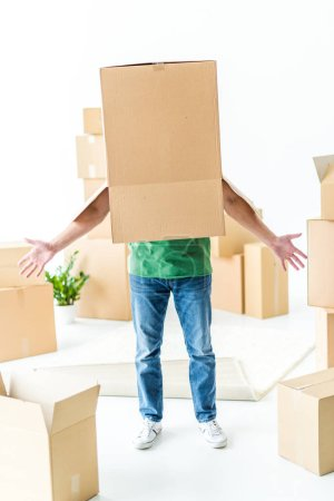 Photo for Young man fooling around with cardboard box on his head isolated on white - Royalty Free Image