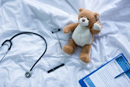 Medical tools and teddy bear