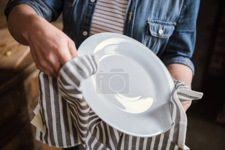 Woman wiping plate