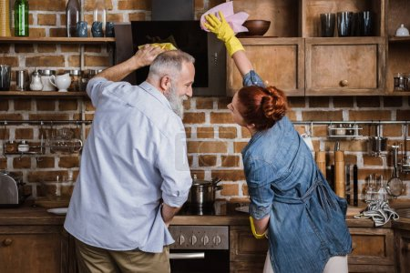 Mature couple in kitchen
