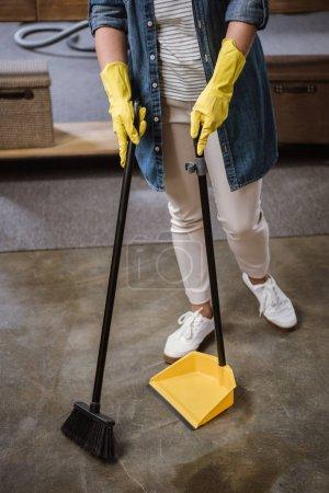 Woman sweeping floor