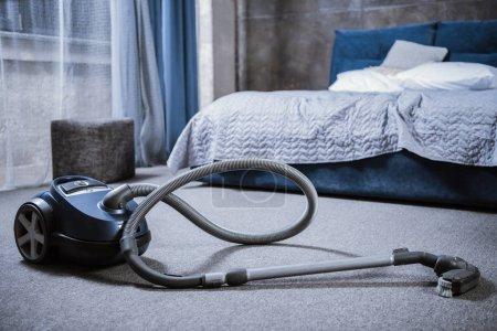 Vacuum cleaner in bedroom