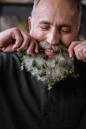 Senior man with greens in beard