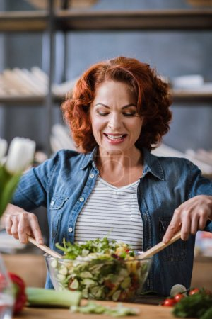 Woman cooking vegetable salad
