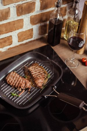 Grilled steaks in frying pan