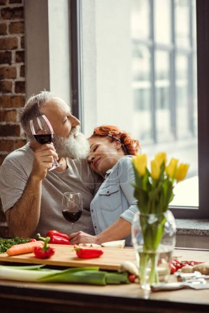 Mature couple with wine