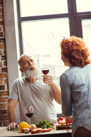 Man trying red wine