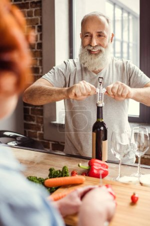 Man openning wine