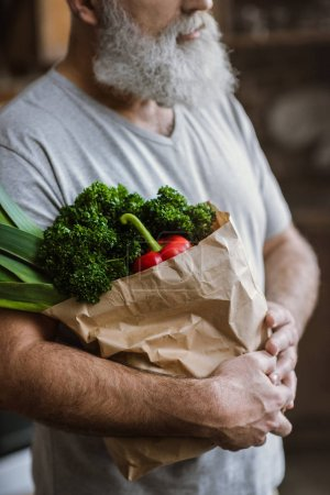 Man with fresh vegetables