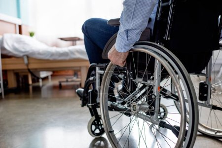 Photo for Partial view of senior male patient in wheelchair at hospital - Royalty Free Image