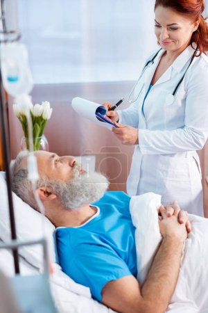 Doctor consulting patient