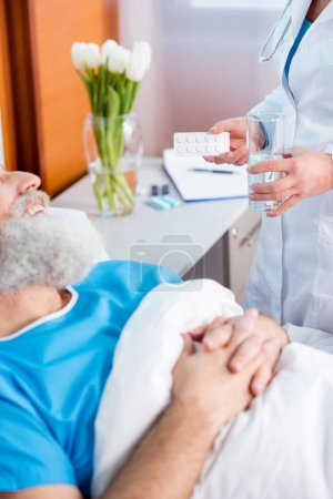 Doctor bringing medicine to patient