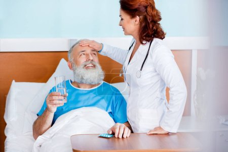 Doctor bringing medicine to patient