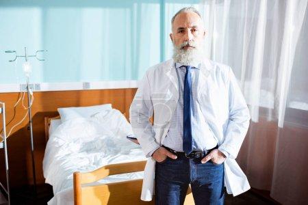 Senior bearded doctor
