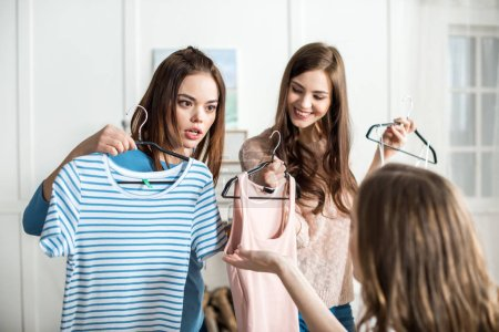 Women choosing clothes