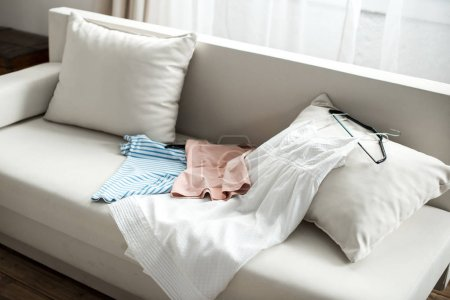 Clothes lying on sofa