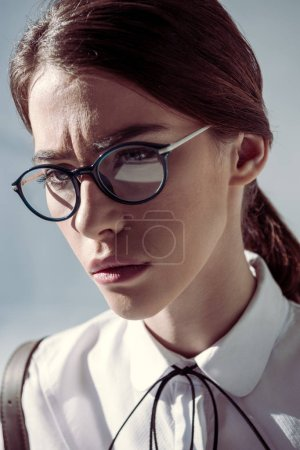 stylish hipster woman in glasses
