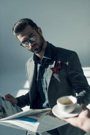 Handsome businessman with newspaper