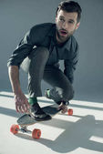 Stylish man riding skateboard