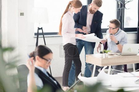 Photo for Professional young businesspeople discussing new business project in office - Royalty Free Image