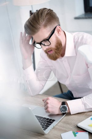 businessman working at table
