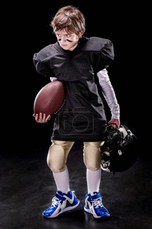 Boy playing american football