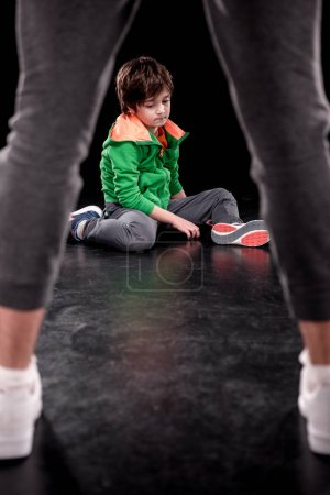Boy sitting on floor