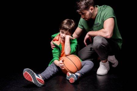 Man and boy with basketball ball
