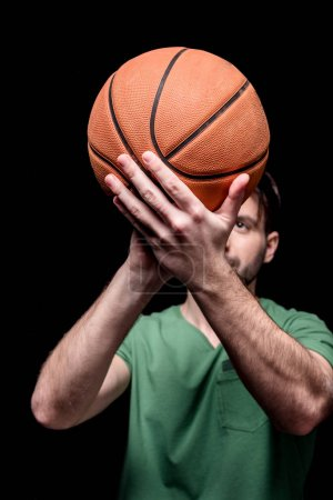 Photo for Close up view of man going to throw basketball ball isolated on black - Royalty Free Image