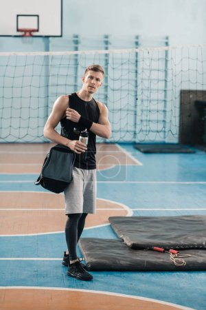 Young sportsman in gym