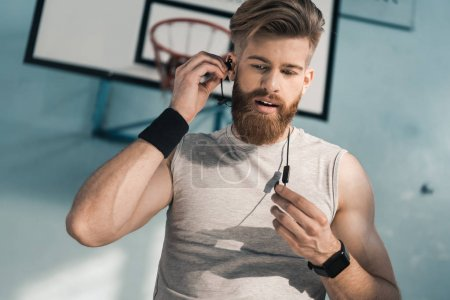 sporty man listening to music