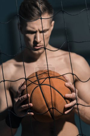 sporty man with basketball ball