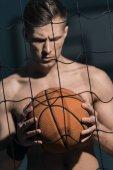 sporty man with basketball ball