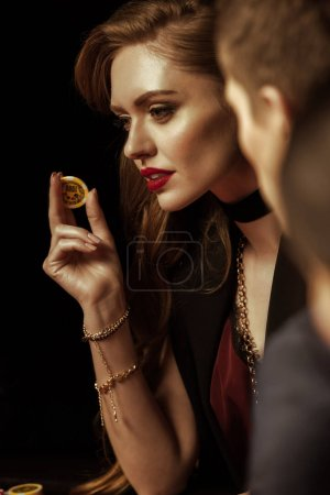 Woman holding casino chip