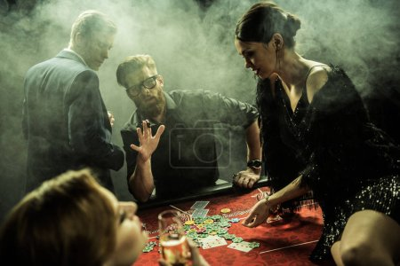 young people playing poker