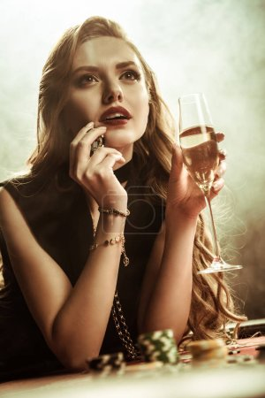 woman holding drink