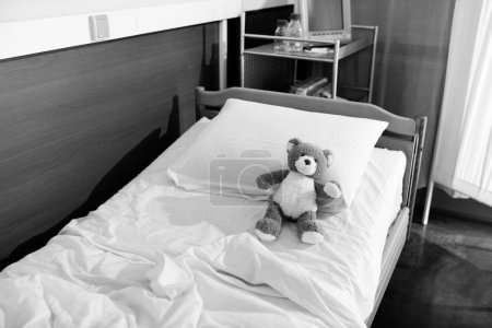 Teddy bear on hospital bed