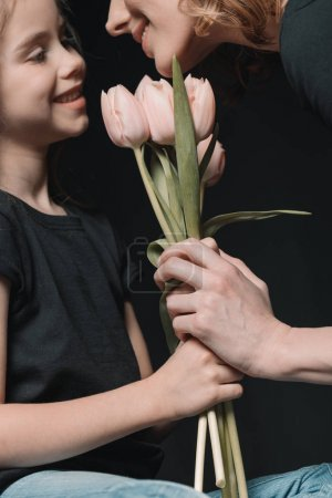 daughter and mother with tulip flowers