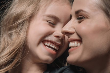 Photo for Portrait of daughter and mother laughing on black - Royalty Free Image